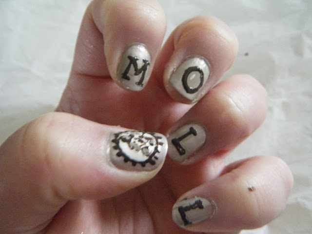 Moll Cutpurse spelled out on nude manicure