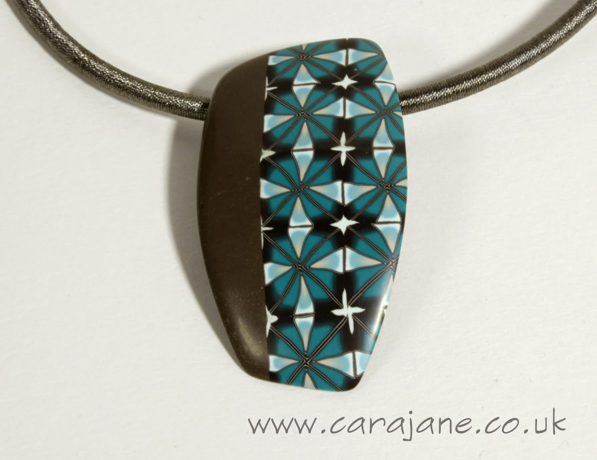 Brown and Teal Polymer Clay Pendant by Cara Jane Hayman