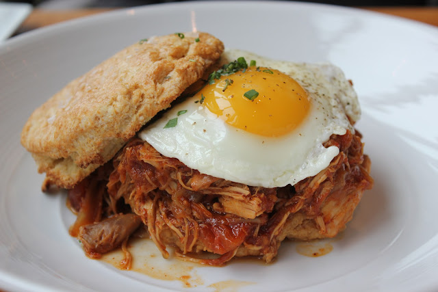 Buttermilk biscuit with barbecued pulled chicken and fried egg at Catalyst, Cambridge, Mass.