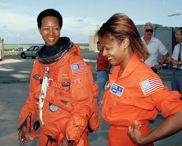 Astronaut Mae Jemison, MD with suit tech Sharon Caples McDougle, First black woman in space, beautiful, radiant, brilliant, orange space suit, NASA, Endeavor Mission, USA, 1992