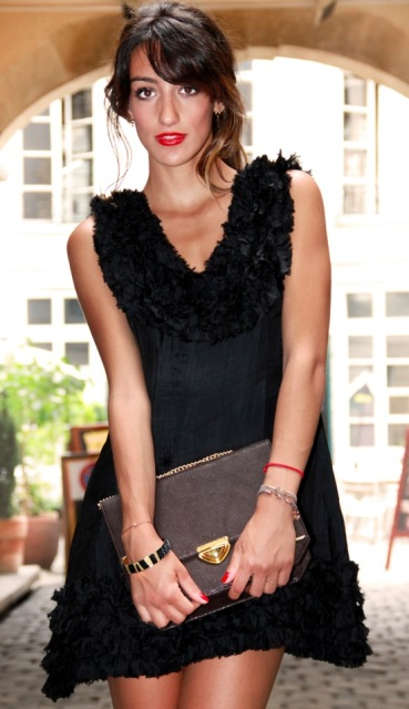 black dress with stylesofia gold clutch bag in paris