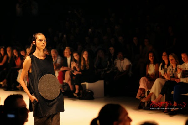 Womens long shift sleeveless top with a large relief circle motif,  Matiny Ng's 580 fashion label at MBFWA Raffles International Showcase, Carriageworks Sydney. Photographed by Kent Johnson.