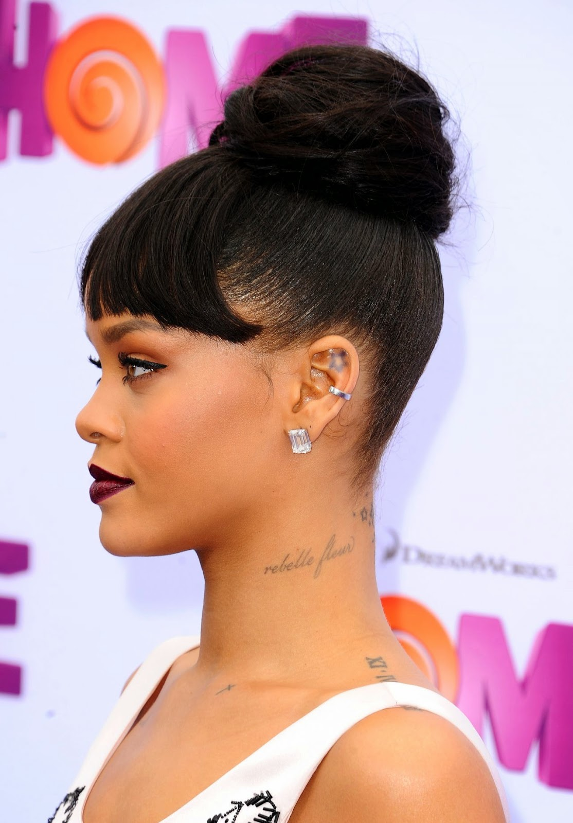 Rihanna goes demure in a satin pink dress at the 'Home' premiere in Westwood
