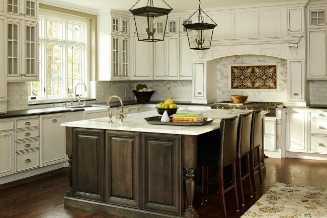 white parameter cabinetry and dark island with dark wood floors