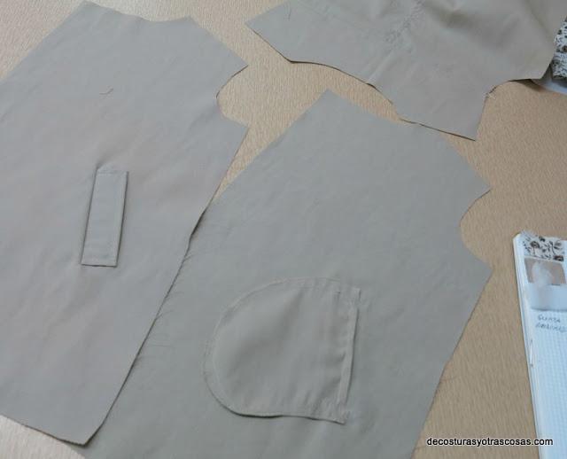 gabardina con bolsillos de tapeta