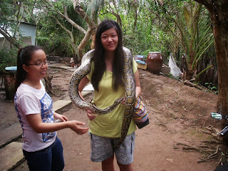 joanna lai carrying a python