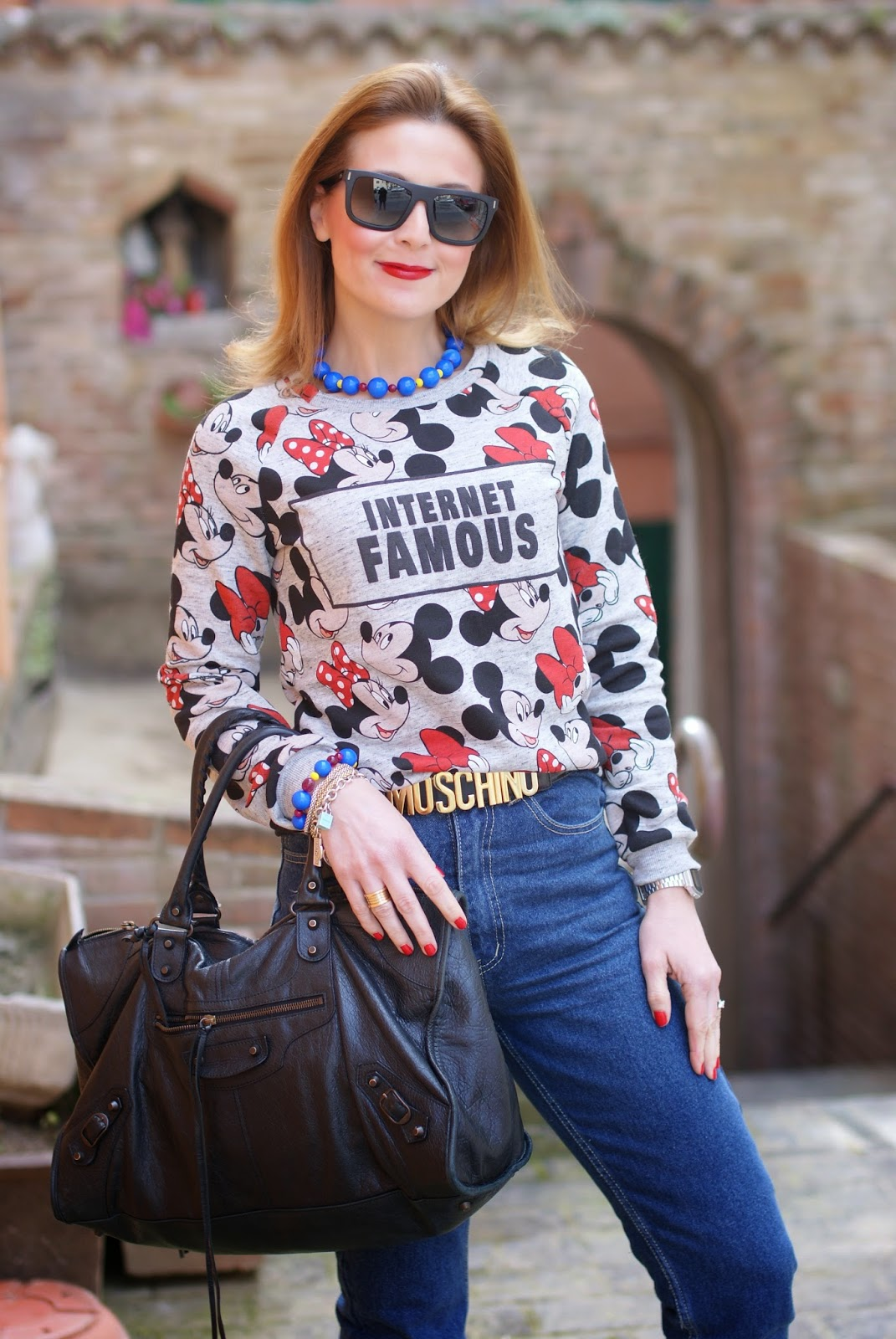 Minnie mouse print, Mickey mouse print sweatshirt, Internet famous top, Bershka sweater, Balenciaga work bag on Fashion and Cookies fashion blog, fashion blogger style
