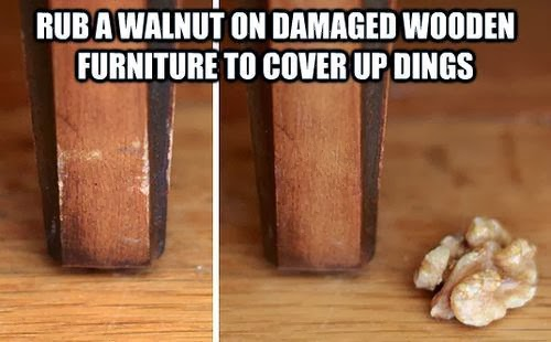 Rub a walnut on damaged wooden furniture to cover up dings