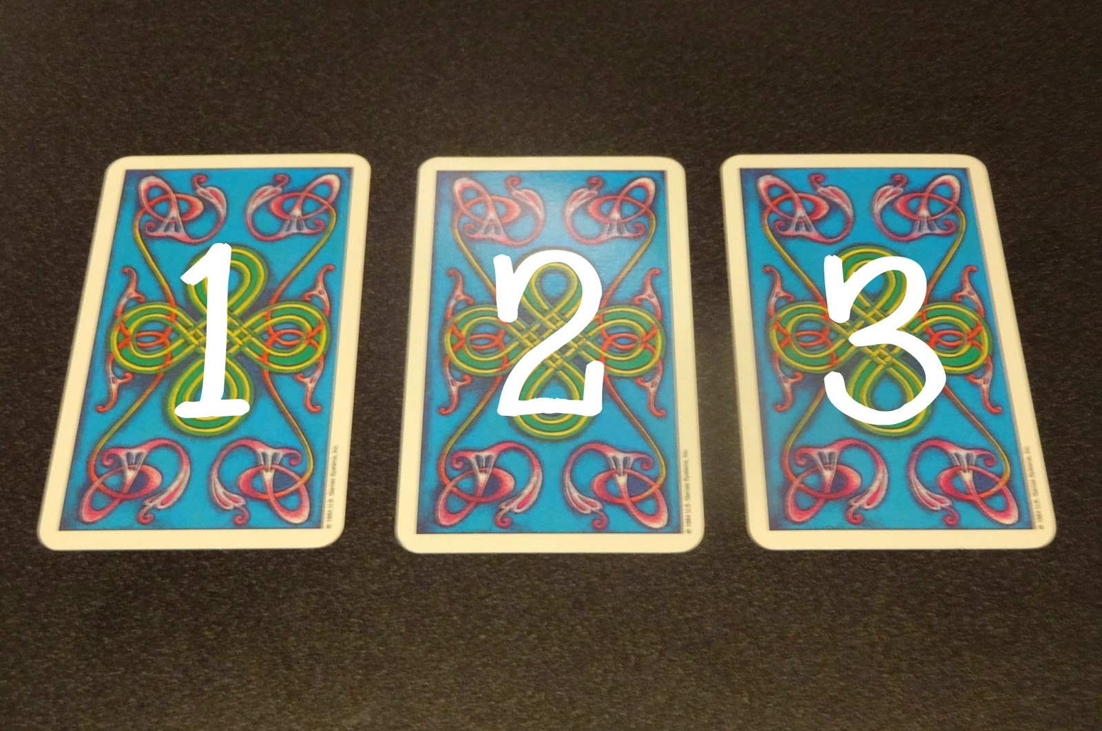 3 cards in a horizontal row