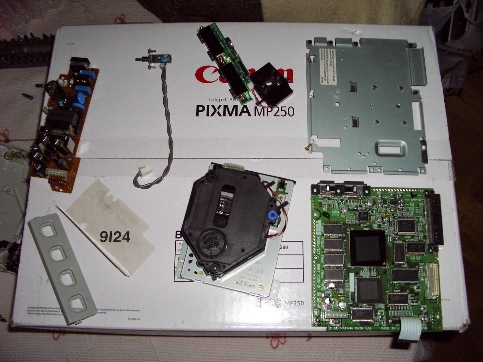 Unidad de GD-ROM separada de su placa adjunta