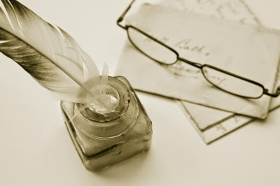 authors writing quill ink paper glasses