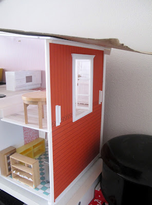 Outside view of  ahlaf-built Lundby dolls' house, showing french doors to where a balcony should be.