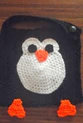 http://translate.google.es/translate?hl=es&sl=en&tl=es&u=http%3A%2F%2Fwww.crochetaddictuk.com%2F2013%2F12%2Fpenguin-baby-bib-free-crochet-pattern.html