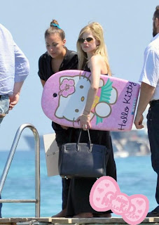 Avril Lavigne and Hello Kitty Bodyboard at the beach