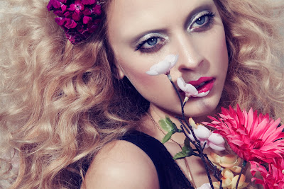 vesna parcina model, woman holding flowers, woman smelling flowers