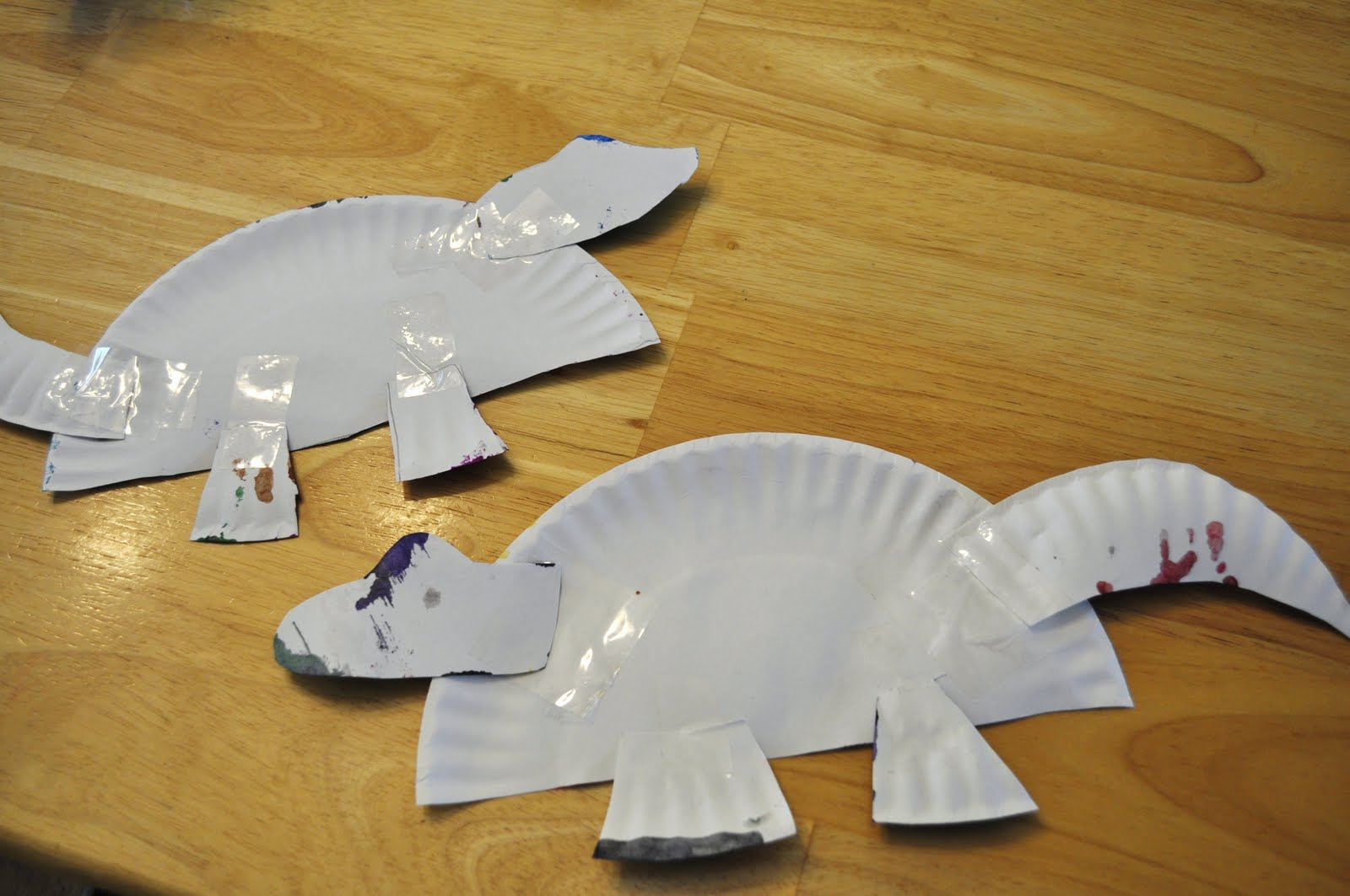 3) Tape and/or glue the parts to the body. & Paper Plate Dinosaur Craft - Kids Activities   Saving Money   Home ...