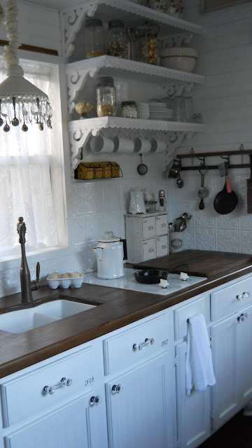 Shabby chic tiny retreat tiny house update for Pictures of updated galley kitchens
