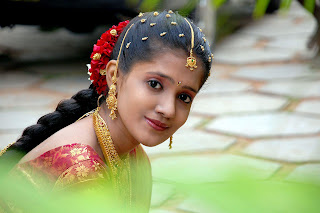 Traditional bridal hair style by Tamil Nadu culture.