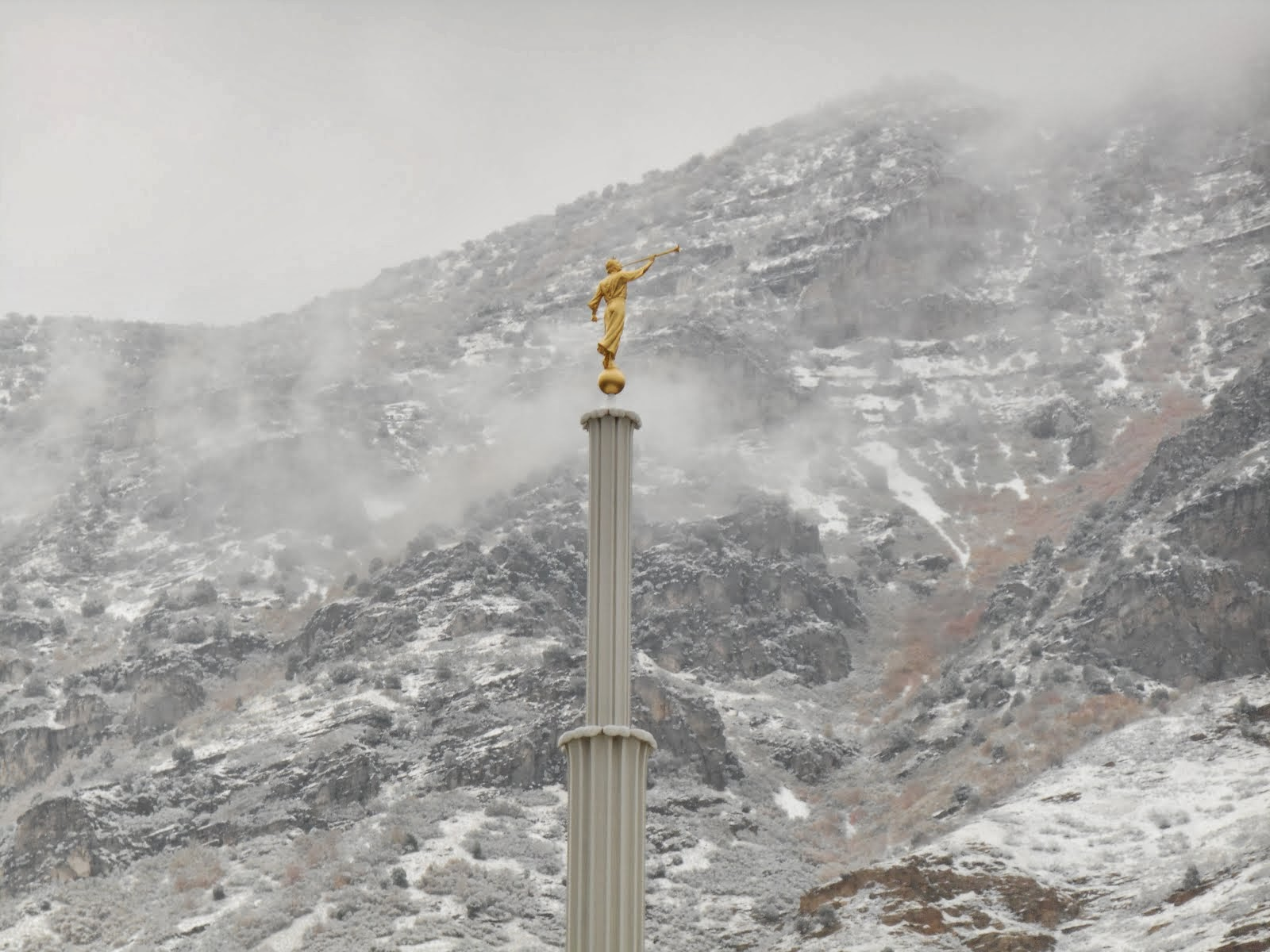 Angel Moroni on snowy backdrop