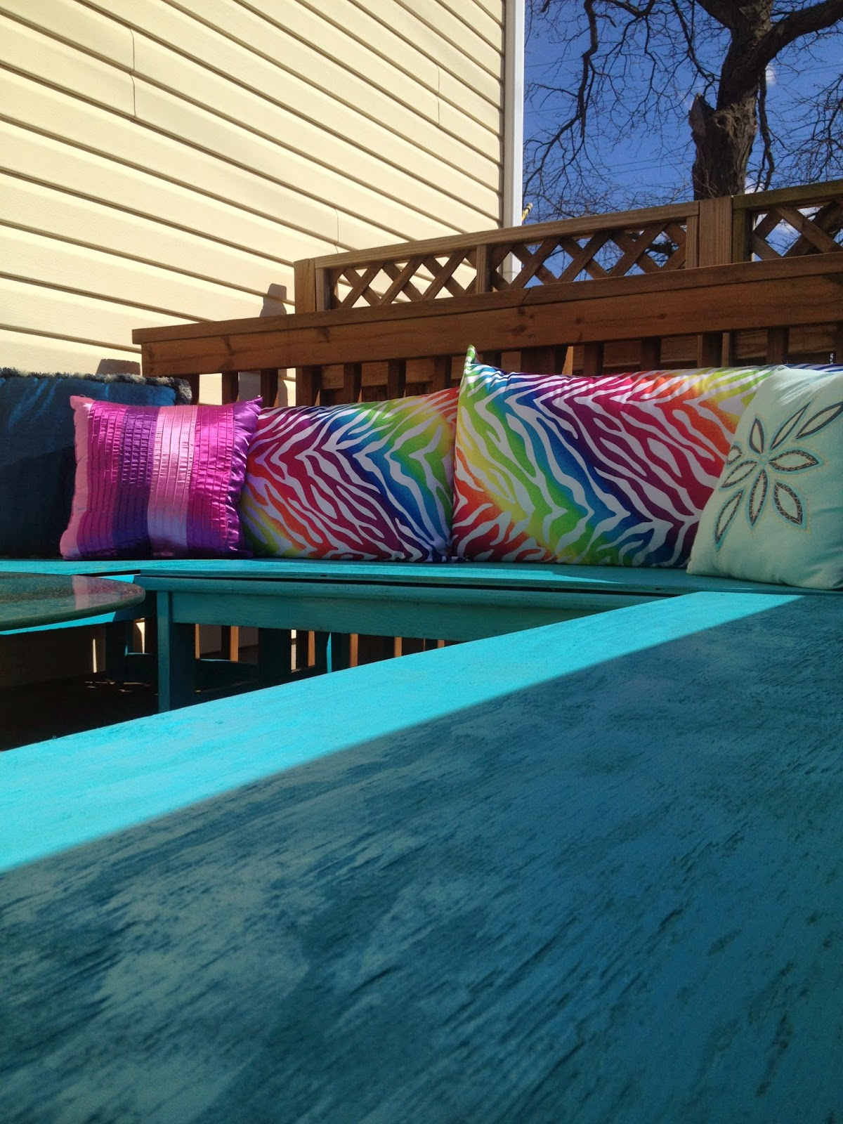 Colorful DIY outdoor deck seating benches makeover pillows