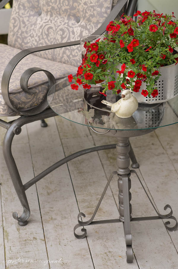 What can you do with a metal plant stand?  Add a piece of glass to the top and create an accent table for your outdoor furniture.  |  anderson + grant