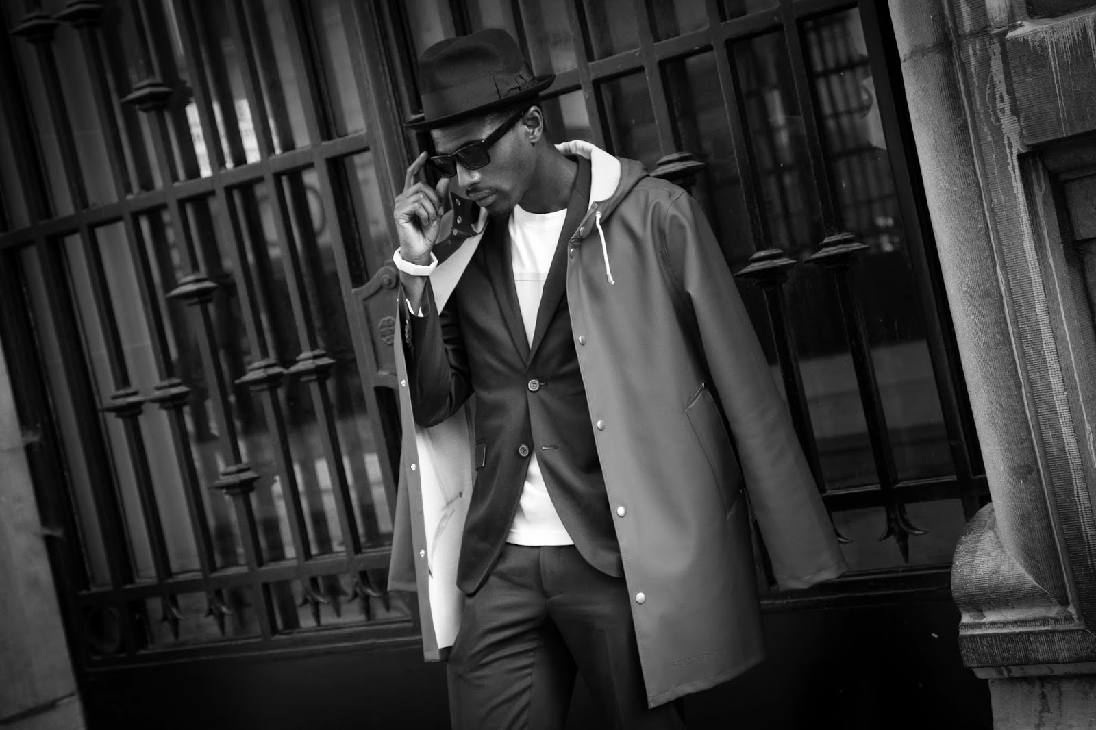 Espionage editorial suits sunglasses l'homme rouge stutterheim raincoat
