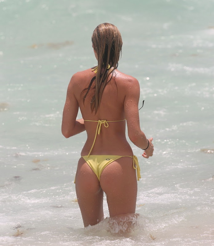 Candice Swanepoel wearing a yellow String Bikini at Miami Beach