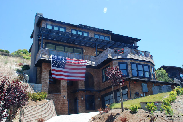 stayathomeista shingle house with giant american flag