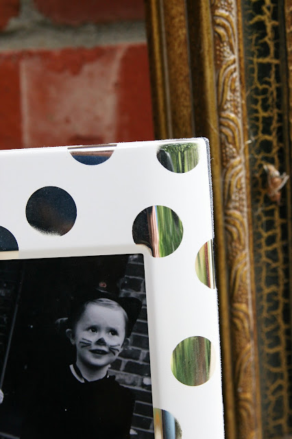 modern silver and white picture frame. DIY with spray paint and stickers.