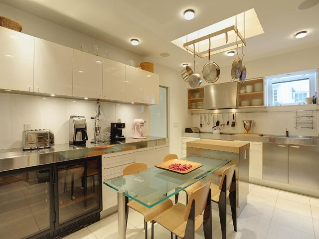 Kitchen and a glass table in the middle in the West Village Apartment, New York