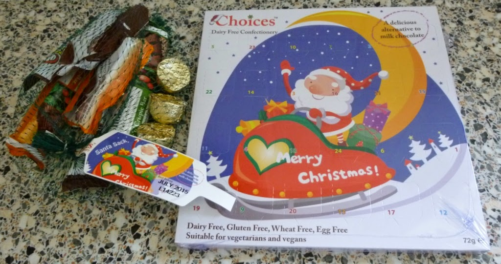 A dairy, gluten, wheat and egg free Advent Calendar and a bag of chocolates for Christmas