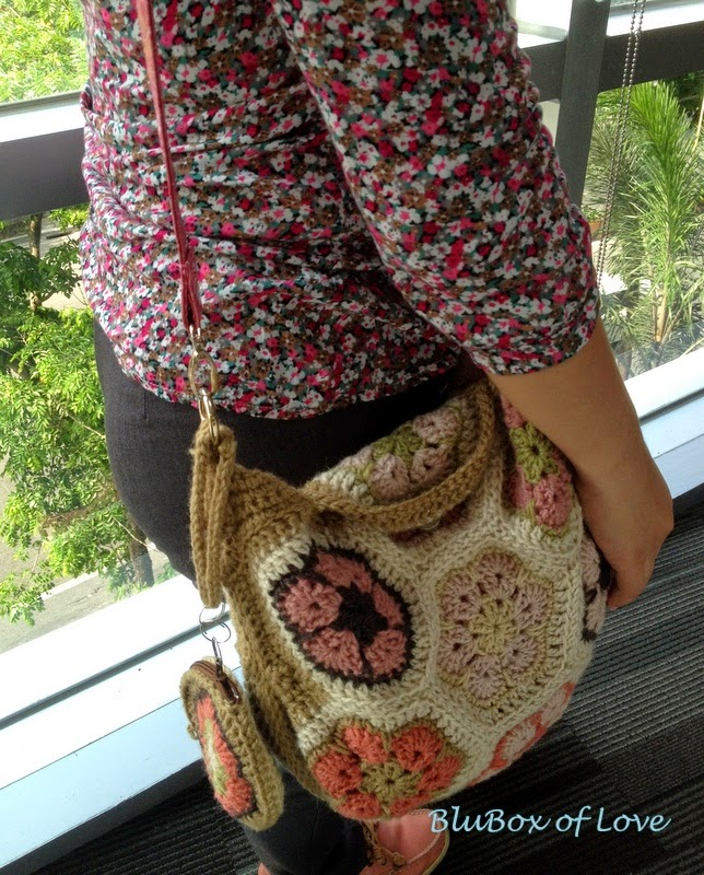 African Flower Crochet Bag when worn