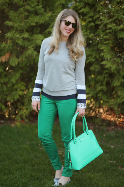 green jeans and embellished sweatshirt