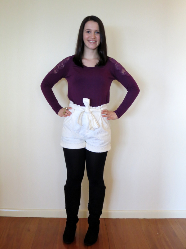 Cream lace shorts, purple lace long sleeve top, black blazer, black tights, boots and gold jewellery