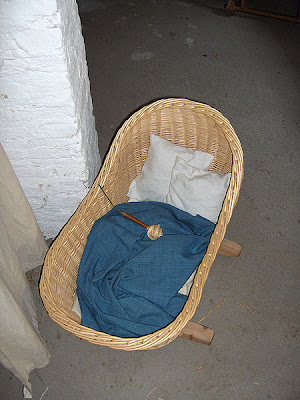 Mediaeval cot and rattle reproduction from Walraversijde archaeological site - by user JoJan at Wikimedia Commons - released under Creative Commons Attribution-Share Alike 3.0 Unported Licence.