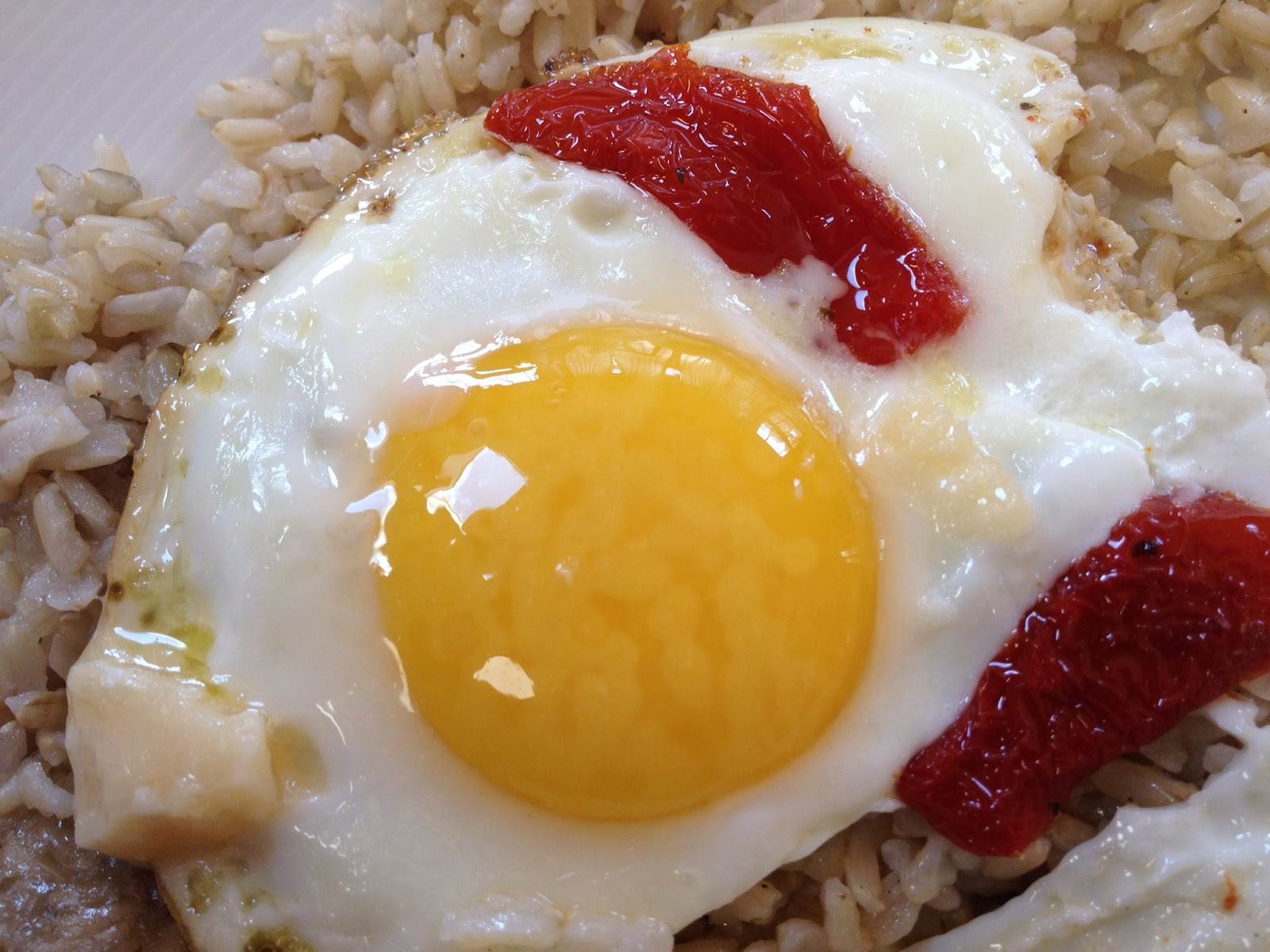 An organic egg with sun-dried tomato and Parmigiano Reggiano cheese.