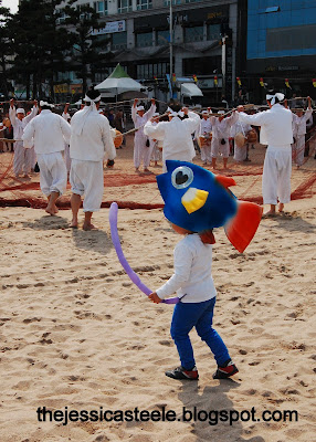 Korean boy wearing fish hat. Gwangan Eobang Festival. Busan, South Korea.