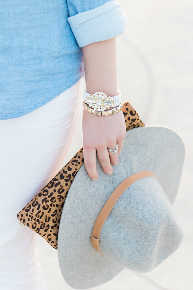 White accessories with a leopard print clutch.