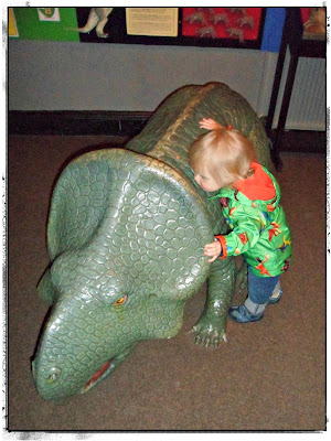 Toddler and dinosaur