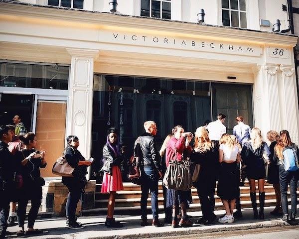 David Beckham wears Saint Laurent by Hedi Slimane leather collar coat at Victoria Beckham store opening September 2014