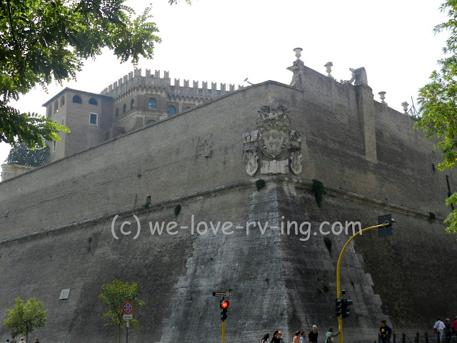 We stand across the street from the Vatican but see little more than the wall that surrounds it.