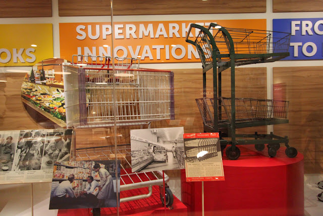 Small shopping cart or trolley in the early days compared to the current big shopping cart at National Museum of American History in Washington DC, USA