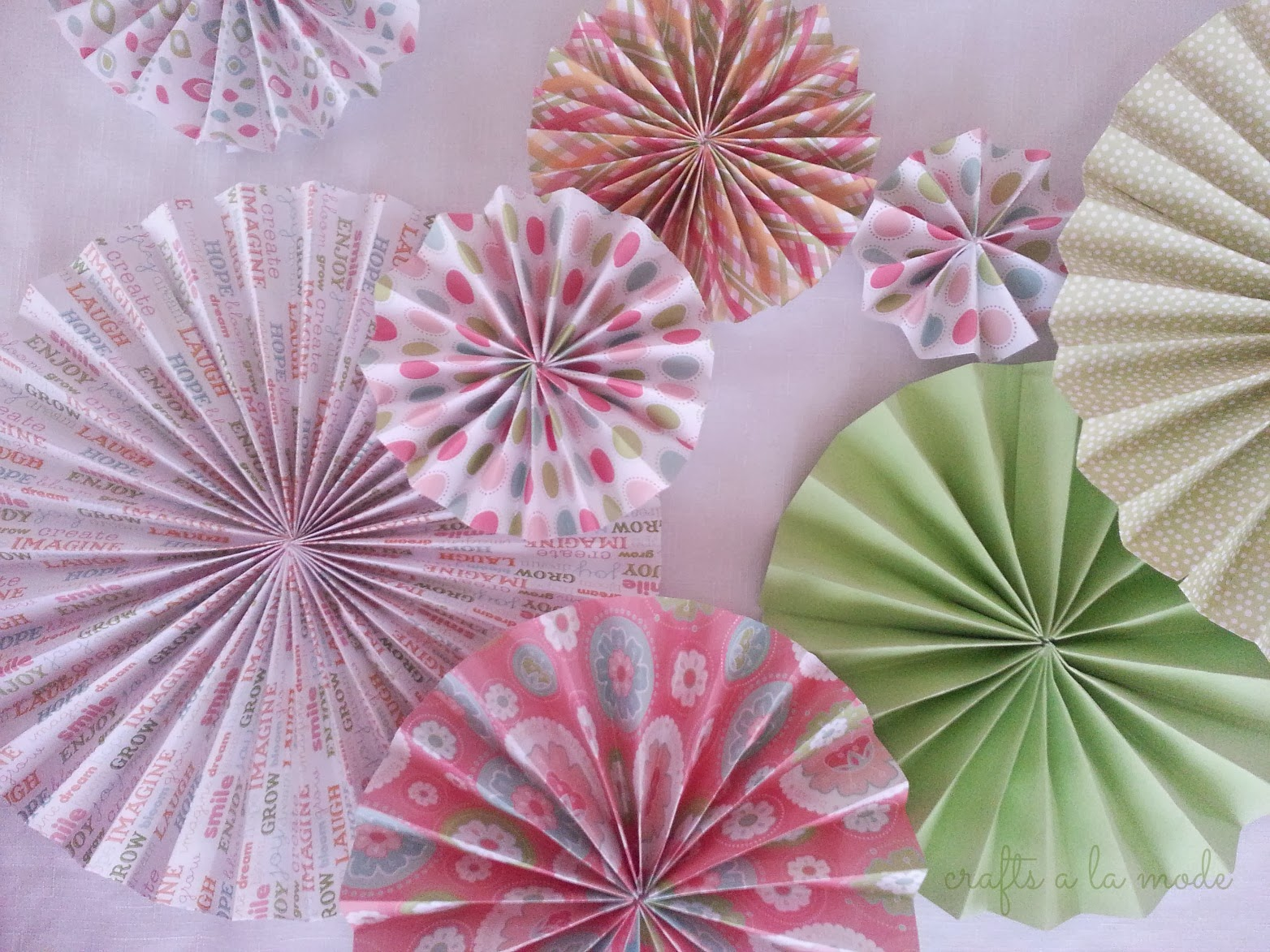 How to make paper rosettes crafts a la mode pretty pink and green folded paper rosettes here is how to make mightylinksfo Choice Image