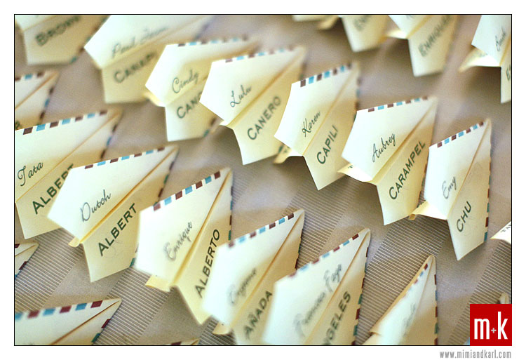 ... with the travel theme, the escort cards were paper airplanes