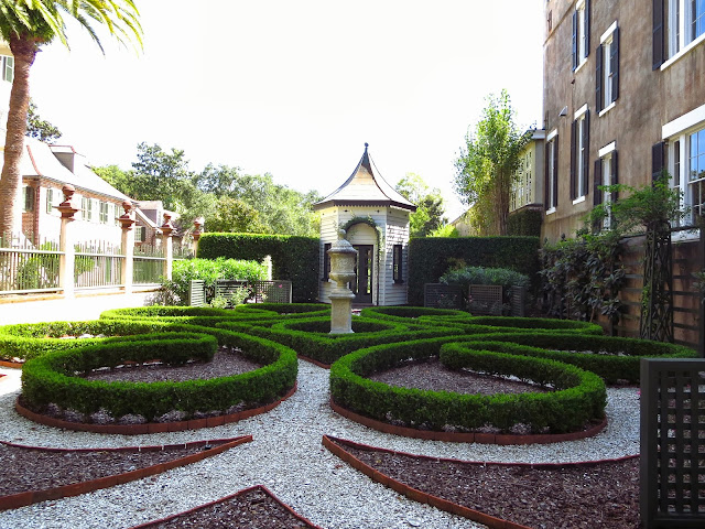 Manicured garden with trimmed boxwoods and crushed gravel in Charleston, South Carolina