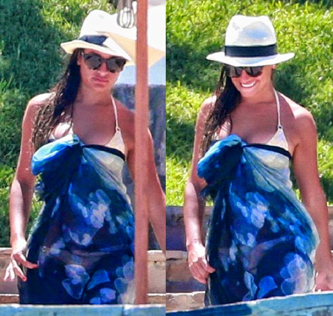 Wait! she showed off again once more her incredible anatomy as she continued her beach holiday in a white bikini on Wednesday, June 25, 2014.