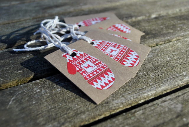http://birdinborrowedfeathers.bigcartel.com/product/mitten-christmas-gift-tags-by-key-print-house