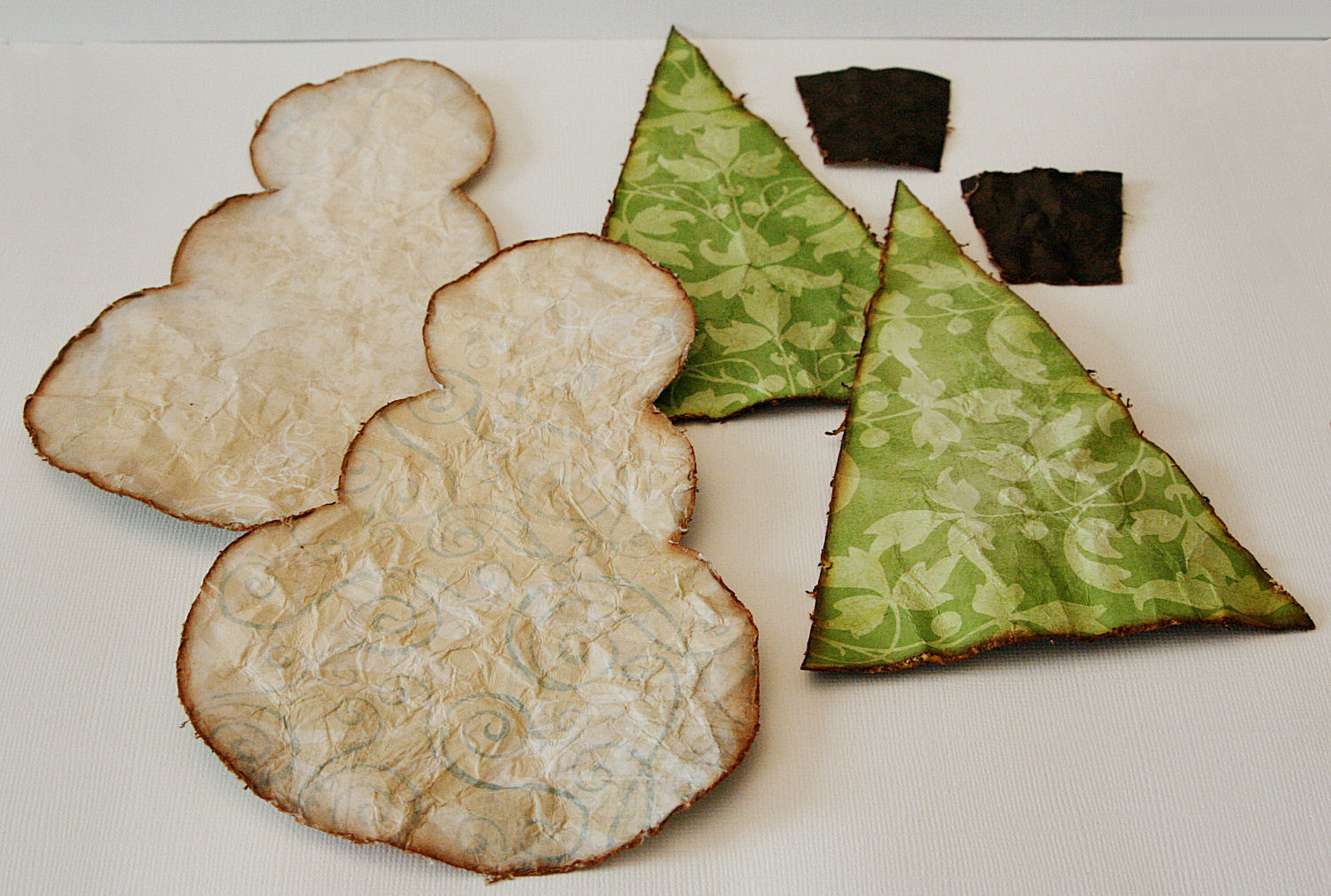 3 once the paper shapes are completely dry prepare them to be stitched together this is a good time to attach a ribbon or string to hang the ornament - Handmade Christmas Ornaments