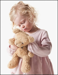 Picture image of little girl with teddy bear