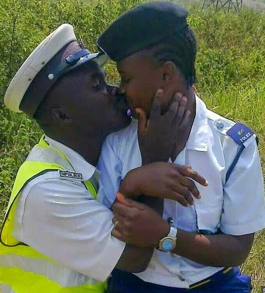 tanzanian traffic police kissing